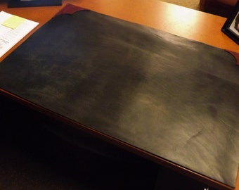 Handmade leather desk mat with scalloped edges