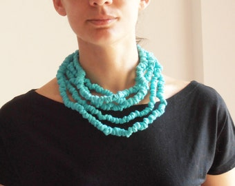 Fabric light turquoise knots necklace