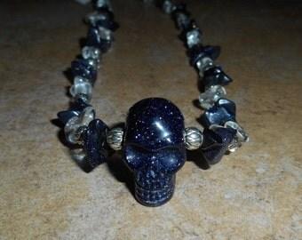 Blue goldstone crystal skull necklace