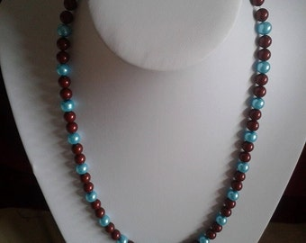 this necklace was made using claret and blue swarlfski glass pearl beads