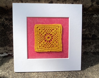 Yellow Crochet square picture with pink patterned background