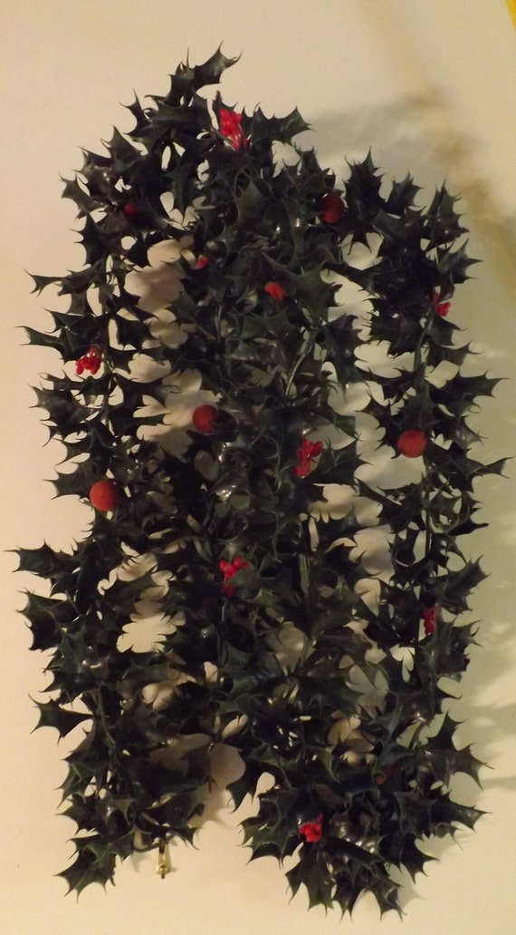 Vintage plastic christmas garland with holly and berry
