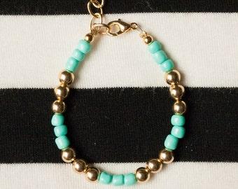 """Gold & Turquoise/Cream/Black """"Goldy Girl"""" Baby Bracelet"""