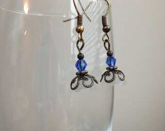 Dangling Brass and Blue Flowers