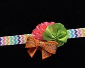 Pink Ruffle Silk Flower with Lime Green Satin Dot Flower and Orange Sequin Bow on Rainbow Chevron Elastic Headband