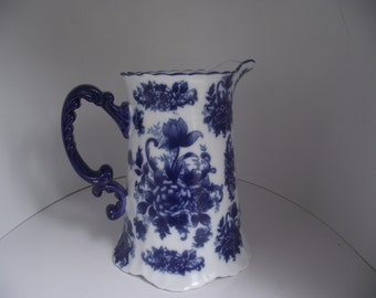 Beautiful blue and white porcelain pitcher with blue flowers