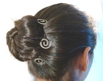 Three small spiral hair pins