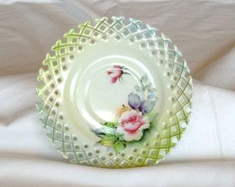Pierced teacup saucer