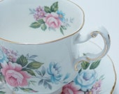 "Paragon Vintage Fine Bone China Tea Cup and Saucer ""Flower Festival B"" Pink Blue Roses Purple Flowers Gold Trim"