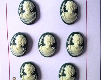 Set of 7 ivory on dark green cameo buttons, 18 x 25 mm