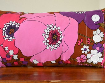 Long cushion made from vintage fabric with button closure. SOLD
