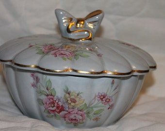 Lovely vintage floral decorated bowl with matching cover topped with a porcelain bow