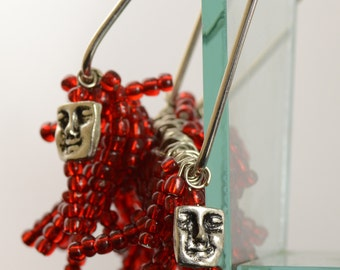 Large Hoop Earrings have silver swinging faces and swaying red glass beads of all different length.  Womens earrings.  Glass beaded earrings