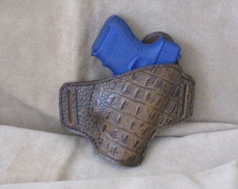 Right hand holster for a model 26 Glock or comparable sized firearm.