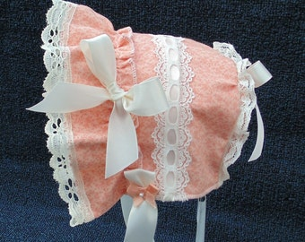 Peach with Ivory lace and bows baby bonnet