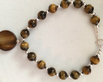 Bracelet of silver with imitation of Tiger eye stones