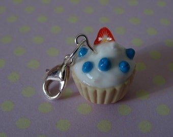 Cupcake charm with blueberry and strawberry topping