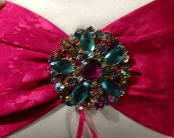 Gem encrusted ring pillow. ribbon to tie rings to. Tassles on each end.
