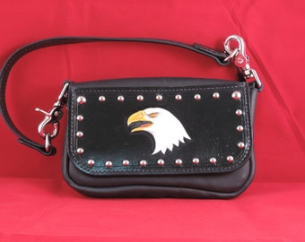 "Purse - Ladies - Leather -Eagle Head & studs in black. Changes to hip bag or belt loop purse w/o handle.  Measures 7.5"" x 4.5"" x 1.75""."