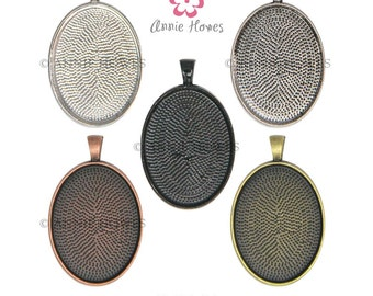 22mm x 30mm Oval Pendant Trays to use with Annie Howes 22mm x 30mm Glamour FX Glass Cabochons. Silver, Copper, Gold, or Black. 25 Pack
