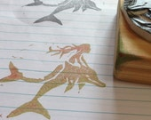 Mermaid on a dolphin hand carves stamp
