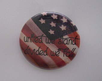 "One 2 1/4"" pinback button United We Stand, Divided We Fall"