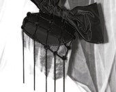 Black Fascinator with an Oversized Bow and a Black Chain Spotted Veil