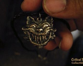 Cheshire Cat Pendant - Alice in Wonderland geek jewelry dark macabre evil silly geekery hatter