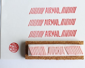 airmail packaging stamp. hand carved hand lettered stamp. snail mail stamp. craft stamp. packaging stamp. gift wrapping. office stationery