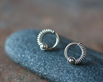 Small Silver Circle Earrings - unique small sterling silver stud earrings, wire wrapped circle, metal bead, oxidized and polished, unisex