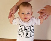 Funny baby one piece. Elements spell NERDY BABY. NOT printed on Gerber brand onesies, we use boutique quality garments. Super soft and thick