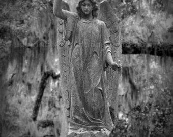 cemetery angel art photo, angel sculpture with a sword and a star, Bonaventure Cemetery Savannah GA, graveyard