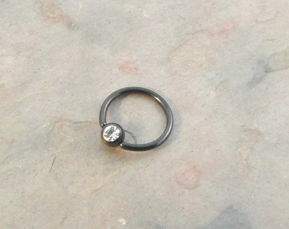 items similar to black hoop cartilage earring with clear