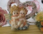 Adorable Baby Cherubs Sitting on Turquoise Cloud In Front Of Heart Created with Glittering Tiny Little Roses, Vintage