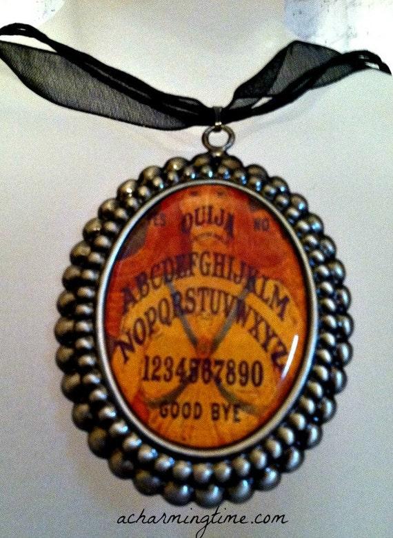 ouija board pendant necklace vintage style photo on a