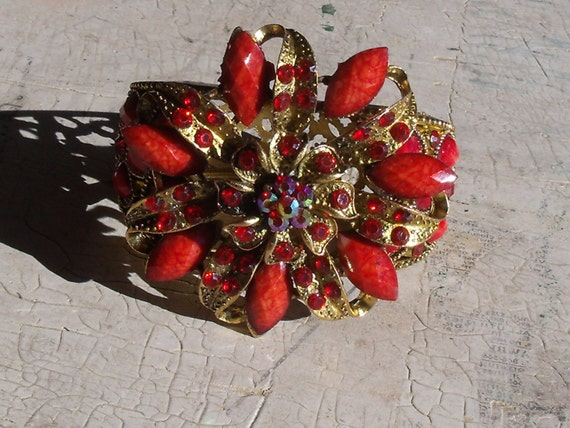 Collectible 1970s Hinged Brass Colored Filigree Bracelet With Red Stones And Floral Motif Unmarked