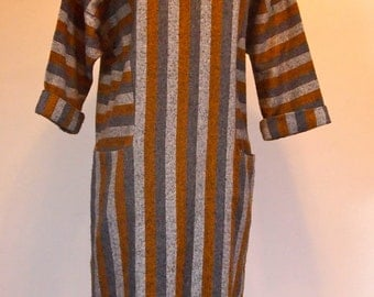 Vintage 1980s grey and brown striped long sleeved dress with roll collar and bat wing sleeves