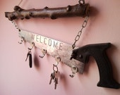 Welcome Home KEY HOLDER from pad saw and key hooks chain hanging on a ...