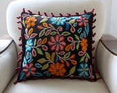 Decorative cushion handwoven black with flowers