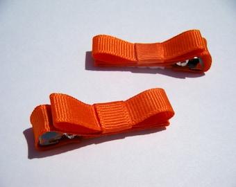 2 Small Orange Hair Bows - No Slip Grip