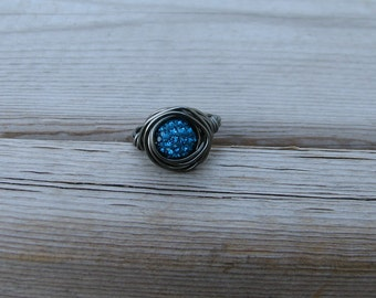 Deep Blue pave bead ring wrapped in gunmetal