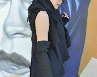 Black open front draped wool vest with lace and muslin details.