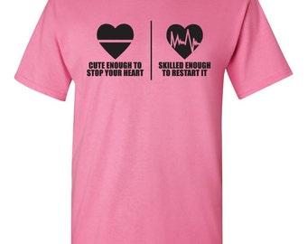 Cute enough to stop your heart - Skilled enough to restart it tshirt. cardiologist tshirt. hospital tshirt. nurse tshirt. heart. TH-082Blk