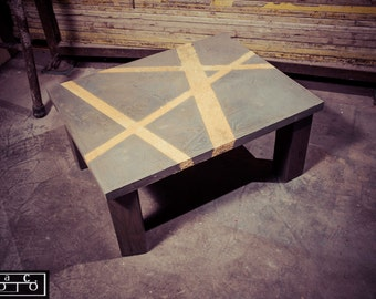 Coffee table with wooden spatula cement regenerated in relief sawdust.Industrial Style.
