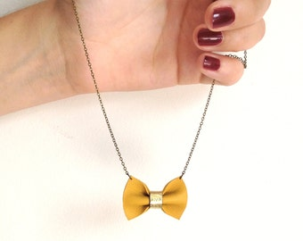 Necklace PAULETTE with a little bow of mustard yellow and bright golden leather
