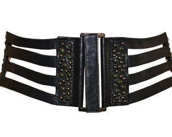 Women's Leather Waist Belt - Black leather and elastic waist belt with gunmetal closure and studs.