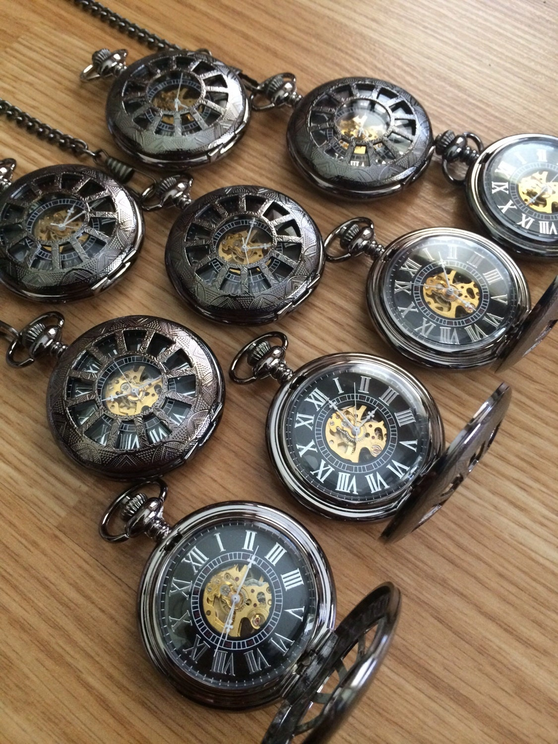 set of 9 engraved mechanical pocket watches by