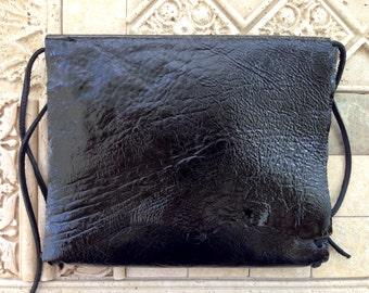 50% off handmade goatskin clutch