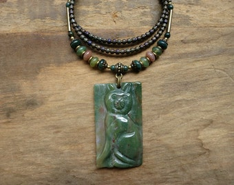 Green Cat Pendant Necklace, carved green jasper feline totem pendant with peach accents, rustic cat Bohemian jewelry