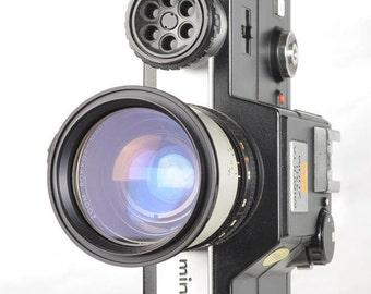 Minolta 110 Zoom SLR Film Camera with Rokkor-Macro 25-50mm Lens Lomograph w/Flash